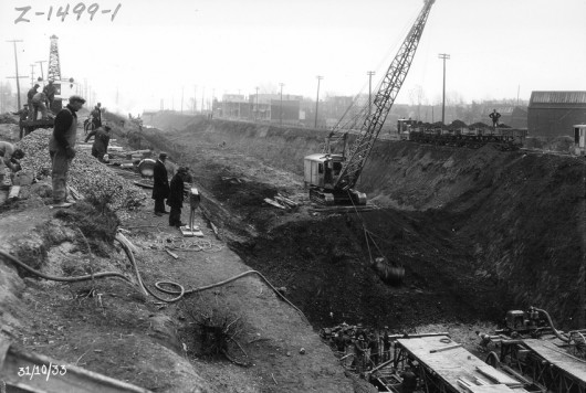 Expanding the riverbed to make way for twin collector sewers in Cote St. Paul (?), 1933